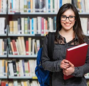 Girl in school library